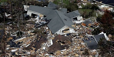 A picture of a house damaged by Hurricane Katrina