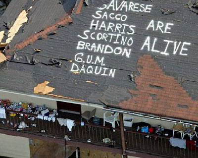 The names of survivors are painted on a roof